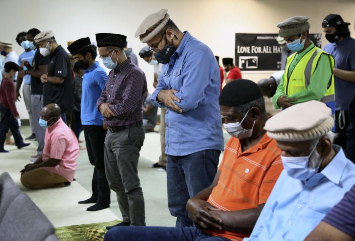 Mansoor Shams, center, and other community members attend Friday prayer on Aug. 13, 2021 in Rosedale, Md. (AP Photo/Jessie Wardarski)