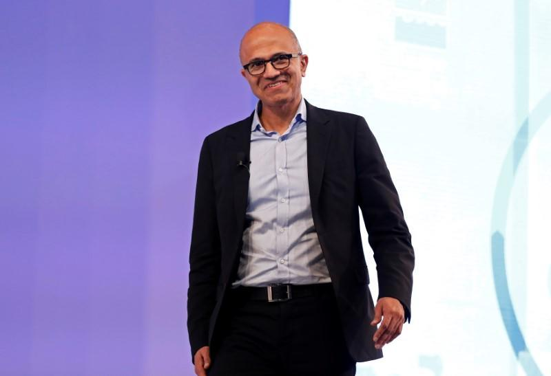 """FILE PHOTO: Microsoft CEO Nadella smiles during his conversation about his latest book """"Hit Refresh"""" in New Delhi"""