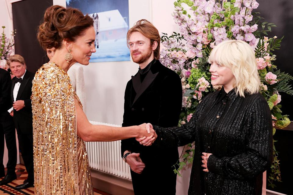 <p>Inside, Kate shook hands with Billie Eilish (with her brother, Finneas O'Connell); the starlet sings the film's title track. </p>