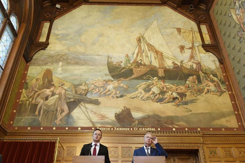 Hungarian Minister of Foreign Affairs and Trade Peter Szijjarto, right, and Hungarian Justice Minister Laszlo Trocsanyi hold a joint news conference after the decision of the Court of Justice of Luxembourg about the EU migrant quotas at the Parliament in Budapest, Hungary, Wednesday, Sept. 6, 2017. (Szilard Koszticsak/MTI via AP)