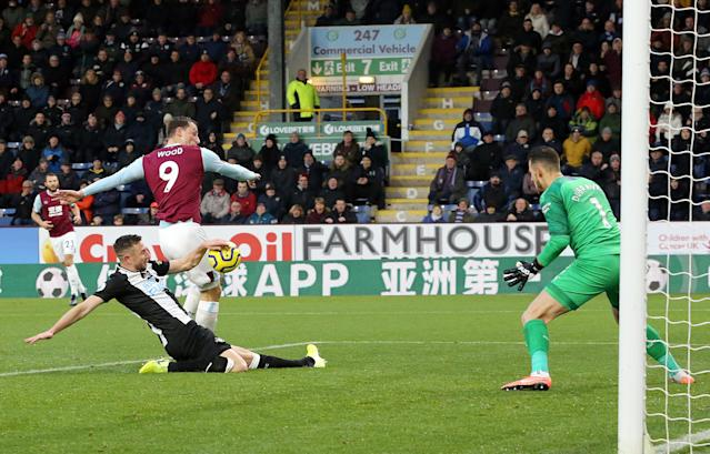 Newcastle United's Paul Dummett appears to handle the ball as he tackles Burnley's Chris Wood in the penalty area. (Credit: Getty Images)