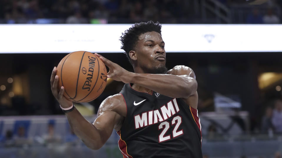 Jimmy Butler enjoys being a leader with the Heat. (AP Photo/John Raoux)