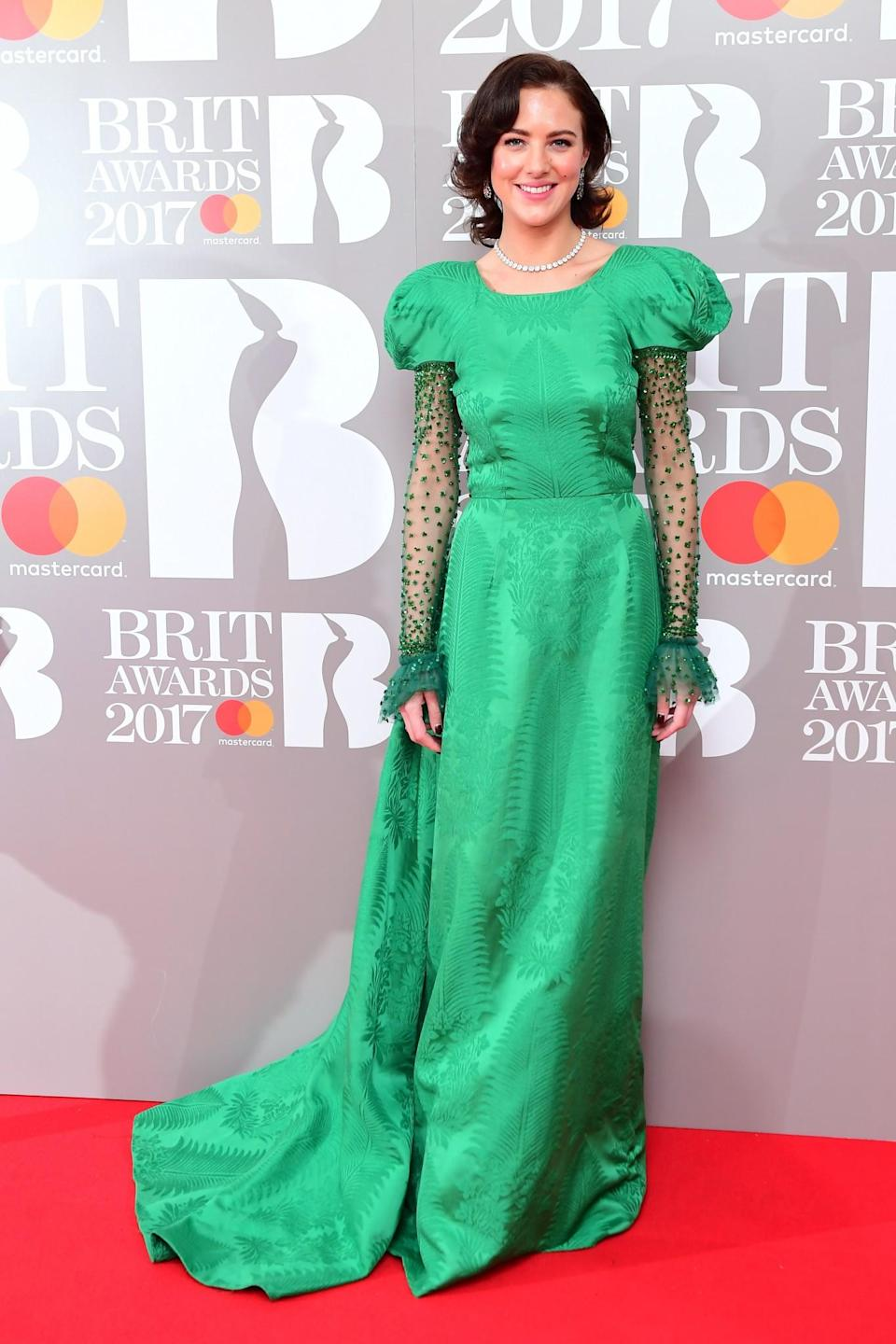 <p>The model opted for a rather old-fashioned green gown. <i>[Photo: PA]</i> </p>