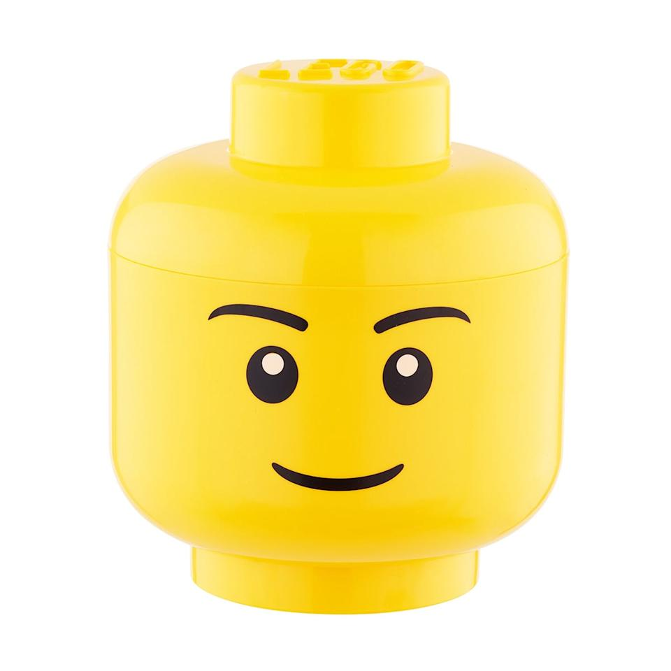 "<p>These <a rel=""nofollow"" href=""https://www.popsugar.com/buy/Lego%20Storage%20Heads-404856?p_name=Lego%20Storage%20Heads&retailer=containerstore.com&price=15&evar1=moms%3Aus&evar9=45667793&evar98=https%3A%2F%2Fwww.popsugar.com%2Fmoms%2Fphoto-gallery%2F45667793%2Fimage%2F45667887%2FLego-Storage-Heads&list1=lego%2Cthe%20container%20store%2Ctoy%20organization%2Cmarie%20kondo&prop13=api&pdata=1"" rel=""nofollow"">Lego Storage Heads</a> ($15) are an easy place to hide things.</p>"