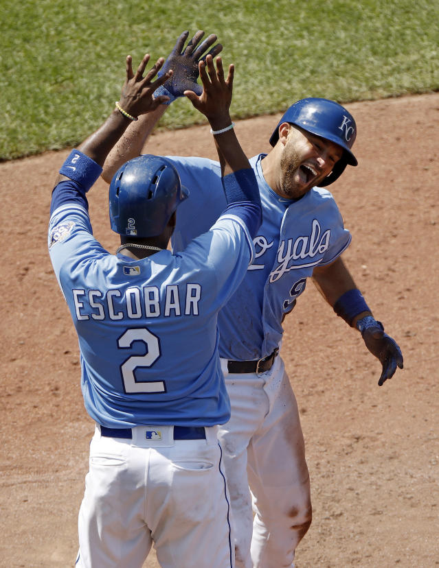 Kansas City Royals' Drew Butera (9) celebrates with Alcides Escobar after hitting a three-run inside-the-park home run during the seventh inning of a baseball game against the Minnesota Twins, Sunday, July 22, 2018, in Kansas City, Mo. (AP Phot0/Charlie Riedel)