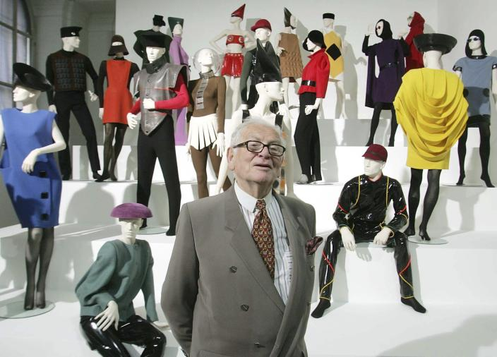 """FILE - In this May 3, 2005 file photo, French fashion designer Pierre Cardin presents his exhibition """"Design and Fashion 1950- 2005"""" at the academy for arts in Vienna, Austria. France's Academy of Fine Arts says famed fashion designer Pierre Cardin has died at 98(AP Photo/Ronald Zak, File)"""