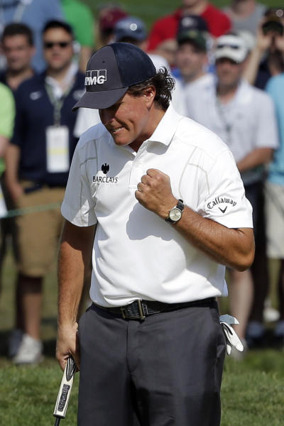 Phil Mickelson reacts after a putt on the sixth hole during the third round of the U.S. Open golf tournament at Merion Golf Club, Saturday, June 15, 2013, in Ardmore, Pa. (AP Photo/Charlie Riedel)