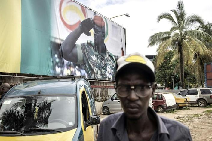A giant billboard shows junta leader Doumbouya, who seized power accusing Conde of authoritarianism (AFP/JOHN WESSELS)