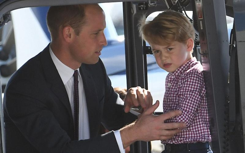 Prince George, pictured in a helicopter with the Duke of Cambridge in Hamburg in July, was 'very envious' when his father tried another form of transport - JULIAN SIMMONDS