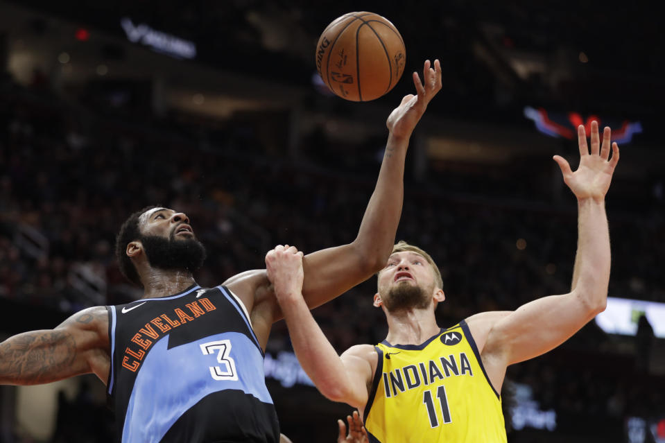 Cleveland Cavaliers' Andre Drummond (3) and Indiana Pacers' Domantas Sabonis (11) battle for a loose ball in the second half of an NBA basketball game, Saturday, Feb. 29, 2020, in Cleveland. Indiana won 113-104. (AP Photo/Tony Dejak)