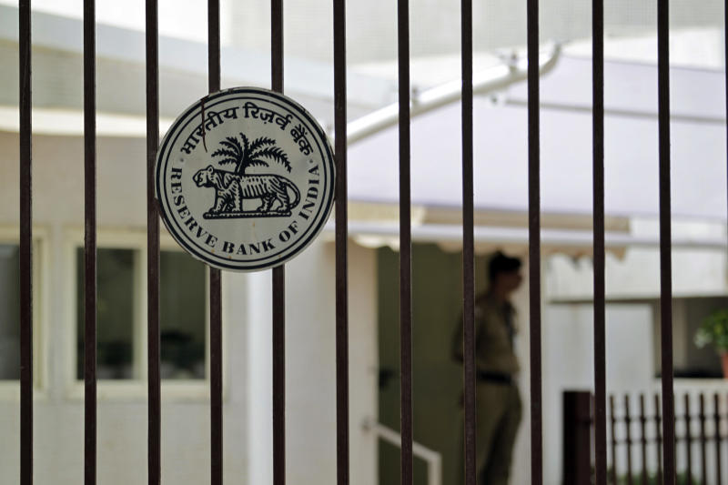 A security man stands inside the Reserve Bank of India (RBI) headquarters in Mumbai, India, Tuesday, July 31, 2012. India's central bank kept its key interest rate on hold Tuesday because of high inflation and warned that a weak monsoon and intensifying global risks will drive down growth faster than anticipated in Asia's third largest economy.( (AP Photo/ Rajanish Kakade)