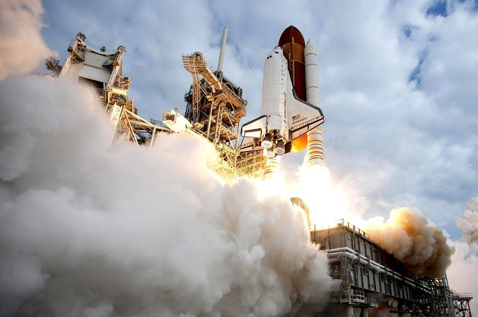 CAPE CANAVERAL, FL - MAY 16:  In this handout provided by National Aeronautics and Space Administration (NASA), NASA space shuttle Endeavour lifts off from Launch Pad 39A at NASA's Kennedy Space Center May 16, 2011 in Cape Canaveral, Florida . After 20 years, 25 missions and more than 115 million miles in space, NASA space shuttle Endeavour is on its final flight to the International Space Station before being retired and donated to the California Science Center in Los Angeles. Capt. Mark E. Kelly, U.S. Rep. Gabrielle Giffords' (D-AZ) husband, will lead mission STS-134 as it delivers the Express Logistics Carrier-3 (ELC-3) and the Alpha Magnetic Spectrometer (AMS-2) to the International Space Station. (Photo by NASA via Getty Images)
