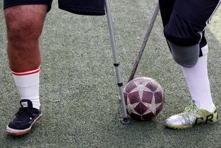 """Members of """"Miracle Team"""", a soccer team made up of one-legged, crutch-bearing soccer players, attend a training session at El Salam club on the outskirts of Cairo, Egypt December 29, 2017. REUTERS/Amr Abdallah Dalsh"""