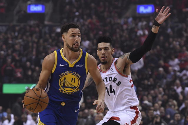 Golden State Warriors guard Klay Thompson drives as Toronto Raptors guard Danny Green defends during the first half of Game 1 of basketball's NBA Finals, Thursday, May 30, 2019, in Toronto. (Frank Gunn/The Canadian Press via AP)