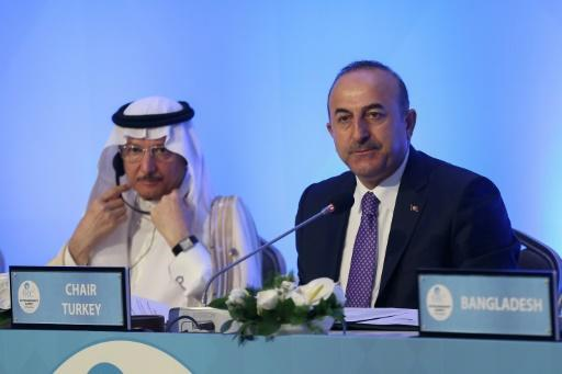 OIC Secretary-General Yousef bin Ahmad Al-Othaimeen (L) and Turkish Foreign Minister Mevlut Cavusoglu listen during a meeting of foreign ministers ahead of a summit of the main pan-Islamic bloc to support Palestinians and condemn Israel