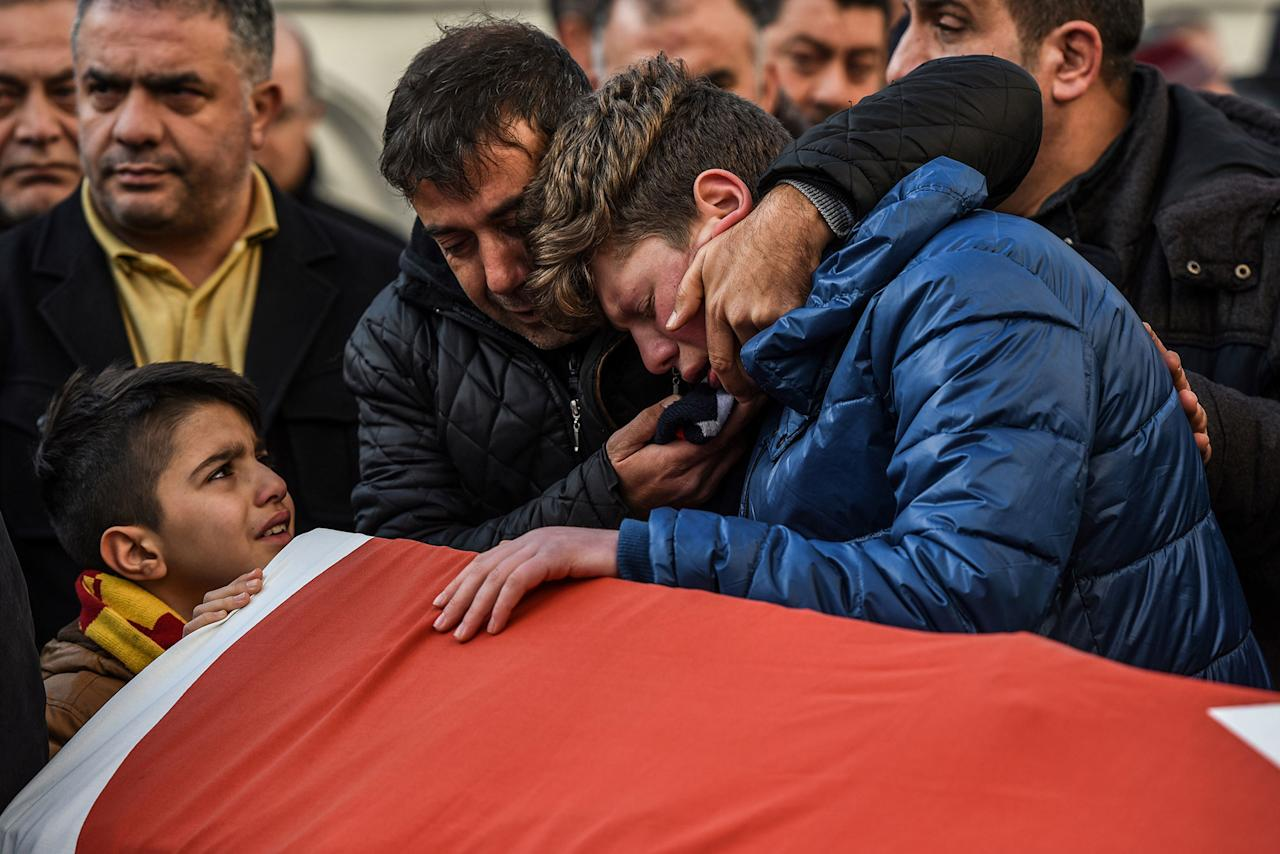 <p>JAN. 1, 2017 – Relatives of Ayhan Arik, one of the victims of the Reina night club attack mourn during his funeral ceremony in Istanbul.<br /> Thirty-nine people, including many foreigners, were killed early on January 1, 2016 when a gunman went on a rampage at an exclusive nightclub in Istanbul where revellers were celebrating the New Year. (Photo: Ozan Kose/AFP/Getty Images) </p>