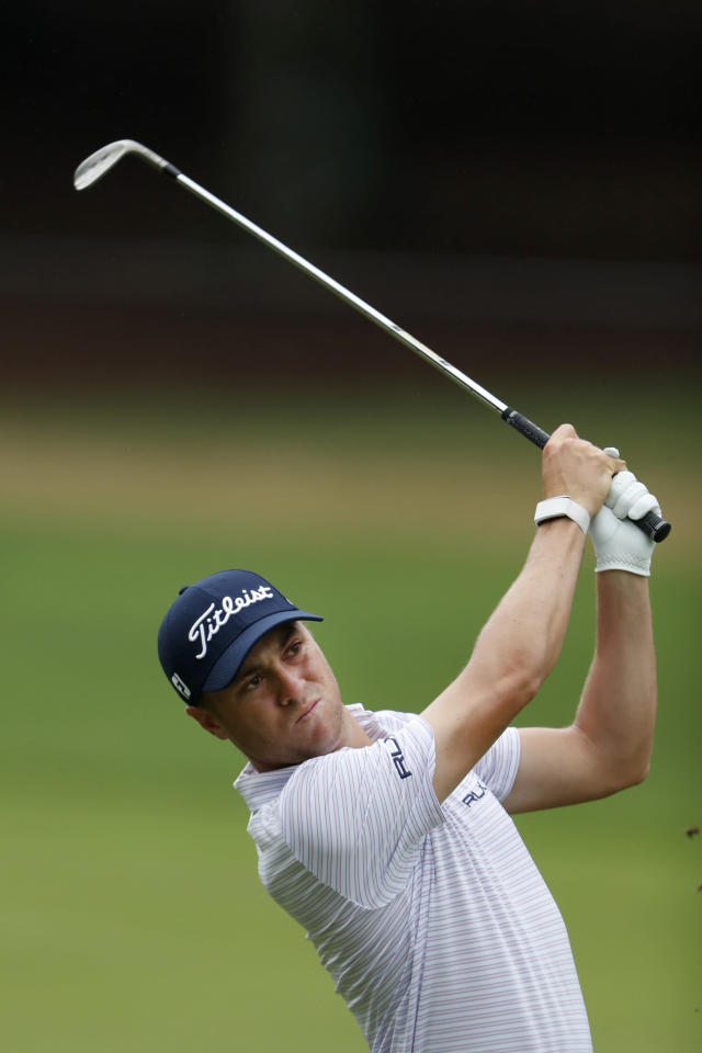 Justin Thomas hits from the fairway on the 13th hole during third-round play in the Tour Championship golf tournament Sunday, Aug. 25, 2019, at East Lake Golf Club in Atlanta. (AP Photo/John Bazemore)
