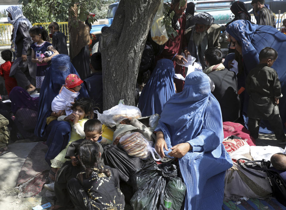 Internally displaced Afghans who fled their home due to fighting between the Taliban and Afghan security personnel, from north provinces are seen at a public park in Kabul, Afghanistan, Monday, Aug. 9, 2021. (AP Photo/Rahmat Gul)