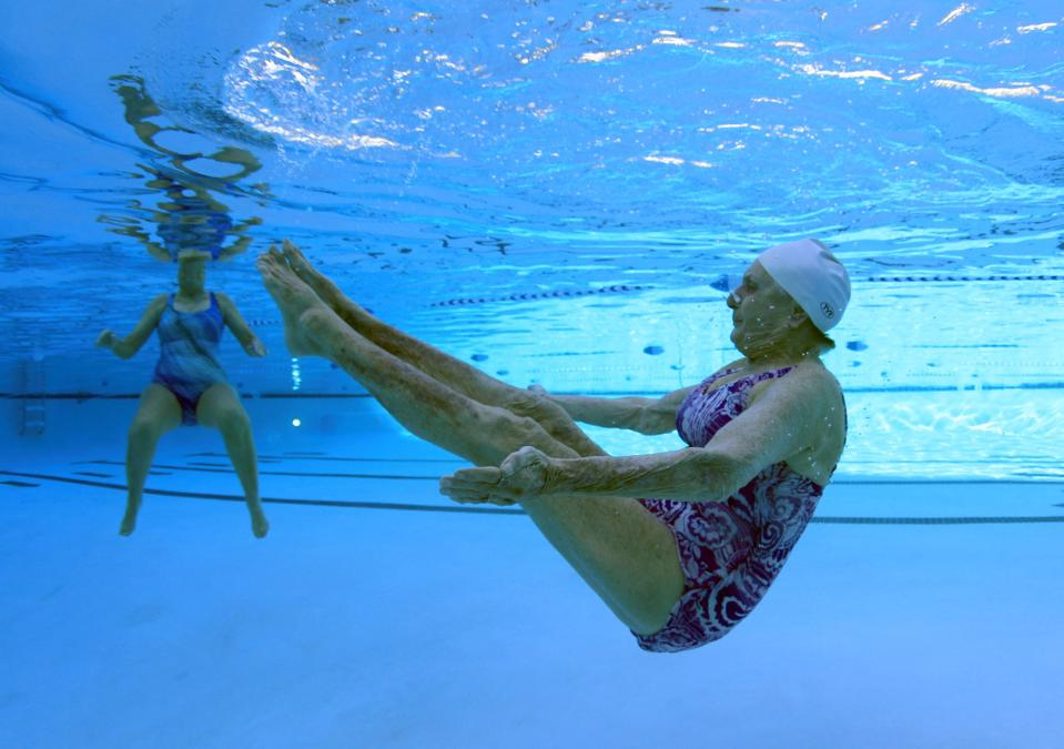 Inge Natoli, 90, (R) who emigrated to Michigan from Germany and has lived in Sun City for 29 years practices synchronized swimming with Barbara Miller, 77, in Sun City, Arizona, January 9, 2013. Sun City was built in 1959 by entrepreneur Del Webb as America's first active retirement community for the over-55's. Del Webb predicted that retirees would flock to a community where they were given more than just a house with a rocking chair in which to sit and wait to die. Today's residents keep their minds and bodies active by socializing at over 120 clubs with activities such as square dancing, ceramics, roller skating, computers, cheerleading, racquetball and yoga. There are 38,500 residents in the community with an average age 72.4 years. Picture taken January 9, 2013.  REUTERS/Lucy Nicholson (UNITED STATES - Tags: SOCIETY)  ATTENTION EDITORS - PICTURE 3 OF 30 FOR PACKAGE 'THE SPORTY SENIORS OF SUN CITY' SEARCH 'SUN CITY' FOR ALL IMAGES