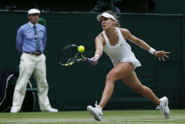 Canada's Eugenie Bouchard plays a return to Petra Kvitova of the Czech Republic during their women's singles final match at the All England Lawn Tennis Championships in Wimbledon, London, Saturday, July 5, 2014. (AP Photo/Sang Tan)