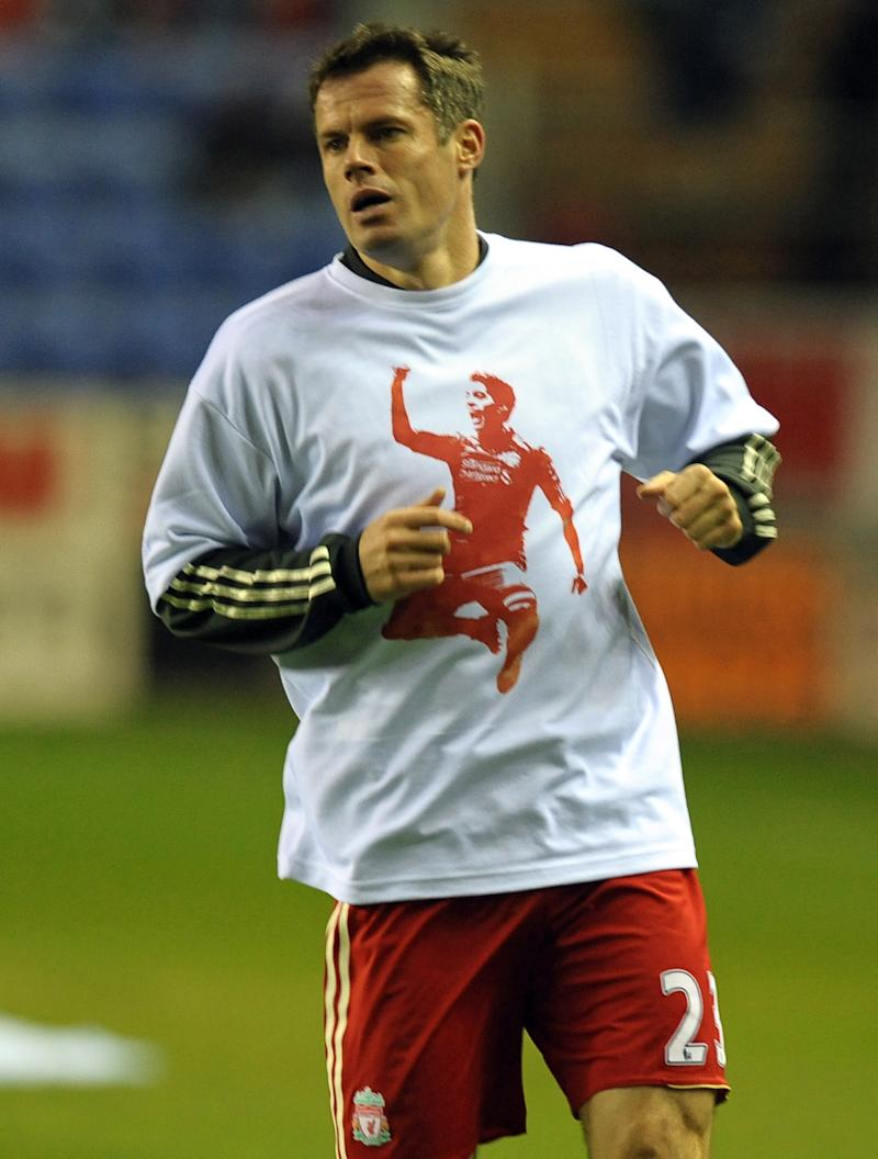 Liverpool's English defender Jamie Carragher warms up wearing a t-shirt supporting team-mate Luis Suarez (PAUL ELLIS/AFP/Getty Images)