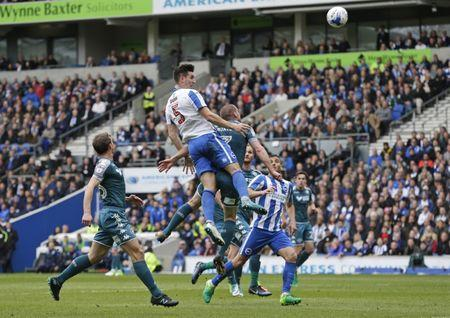Britain Football Soccer - Brighton & Hove Albion v Wigan Athletic - Sky Bet Championship - The American Express Community Stadium - 17/4/17 Lewis Dunk of Brighton and Hove Albion heads at goal. Action Images / Henry Browne Livepic