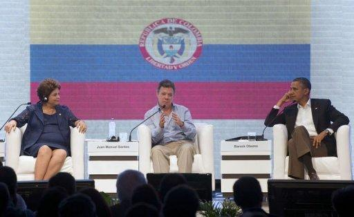 President Juan Manuel Santos (C) of Colombia speaks alongside US President Barack Obama (R) and President Dilma Rousseff