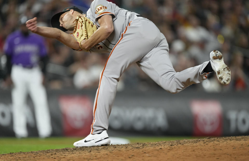 San Francisco Giants relief pitcher Tyler Rogers works against the Colorado Rockies in the eighth inning of a baseball game Friday, Sept. 24, 2021, in Denver. (AP Photo/David Zalubowski)