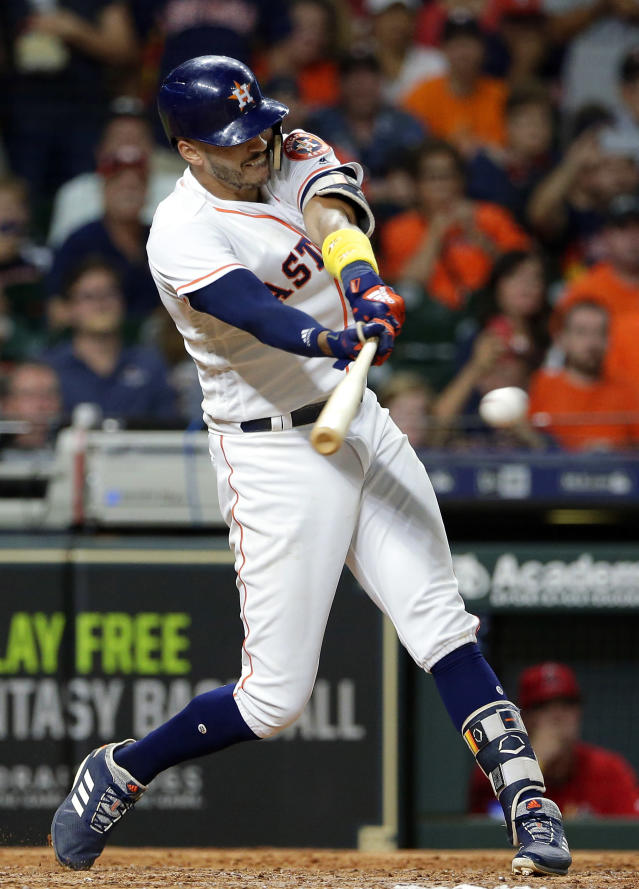 Houston Astros shortstop Carlos Correa (1) connects for a single, driving in the tying run against the Los Angeles Angels during the eighth inning of a baseball game, Saturday, Sep. 1, 2018, in Houston. (AP Photo/Michael Wyke)