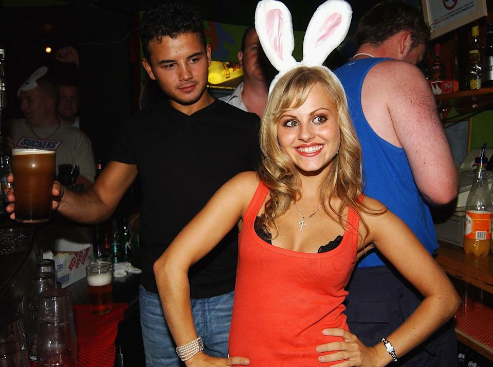 DROGHEDA, IRELAND - AUGUST 14:  Coronation Street star Tina O'Brien and her boyfriend and fellow Corrie character Ryan Thomas (L) celebrate Earth niteclub's 10th Birthday with a Playboy Party on August 14, 2004 in  Drogheda, Ireland.  (Photo by Showbiz Ireland/Getty Images)