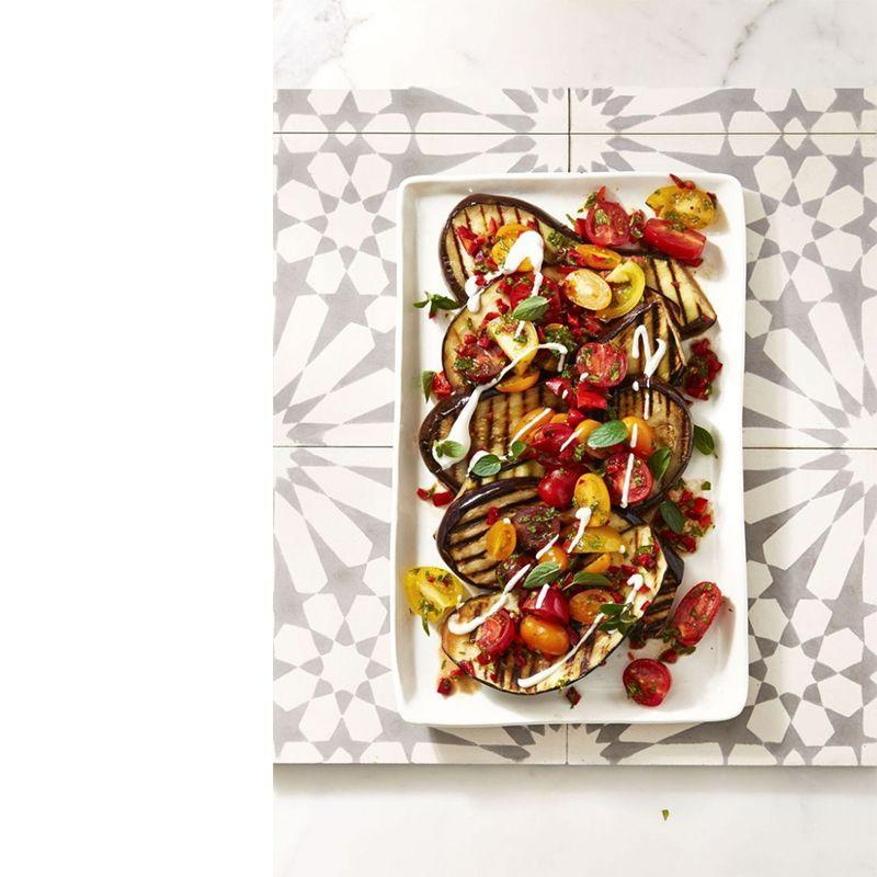 """<p>This gorgeous veggie dish will add serious color to your spread. Grill some veggies, top them with a creamy yogurt mix, and you've got something everyone will love.</p><p><em>Get the recipe from <a href=""""https://www.goodhousekeeping.com/food-recipes/a39935/cayenne-grilled-eggplant-with-fresh-tomato-salad-recipe/"""" rel=""""nofollow noopener"""" target=""""_blank"""" data-ylk=""""slk:Good Housekeeping"""" class=""""link rapid-noclick-resp"""">Good Housekeeping</a>.</em></p>"""