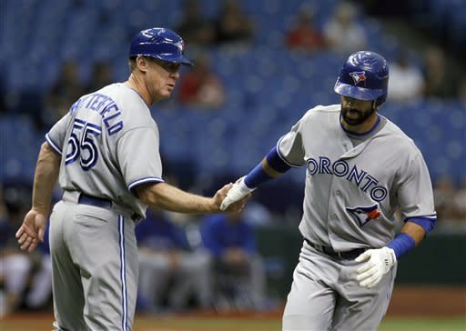 Toronto Blue Jays' Jose Bautista, right, shakes hands with third base coach Brian Butterfield after his first-inning home run off Tampa Bay Rays starting pitcher James Shields during a baseball game Wednesday, May 23, 2012, in St. Petersburg, Fla. (AP Photo/Chris O'Meara)