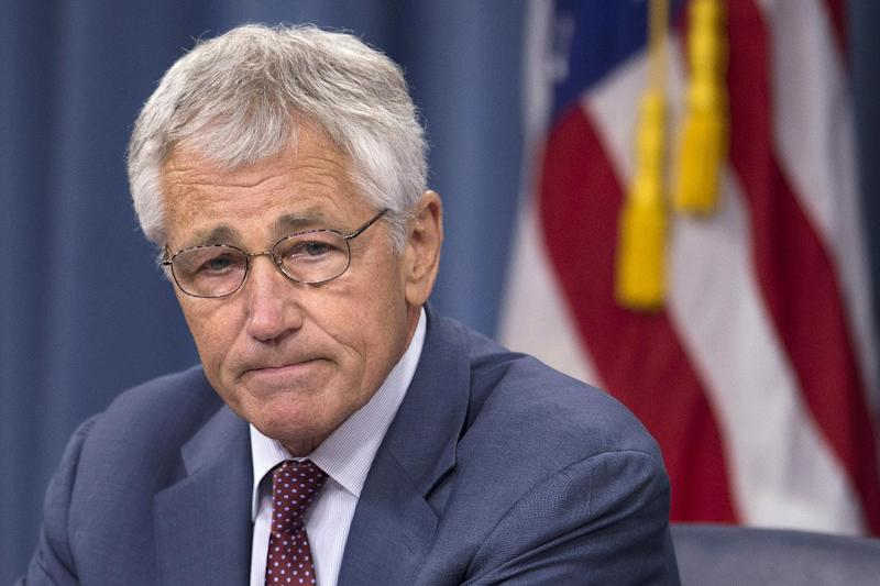 Defense Secretary Chuck Hagel pauses during a news conference at the Pentagon, Wednesday, July 31, 2013. Hagel warned that the Pentagon may have to mothball up to three Navy aircraft carriers and order more sharp reductions in the size of the Army and Marine Corps if Congress does not act to avoid massive budget cuts beginning in 2014. (AP Photo/Evan Vucci)