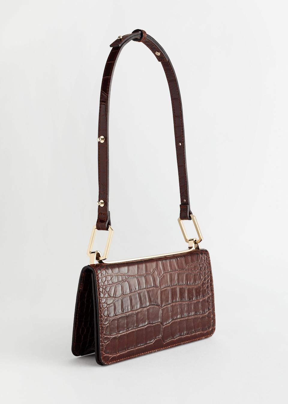 "<br><br><strong>& Other Stories</strong> Duo Buckle Croc Shoulder Bag, $, available at <a href=""https://go.skimresources.com/?id=30283X879131&url=https%3A%2F%2Fwww.stories.com%2Fen_usd%2Fbags%2Fshoulderbags%2Fproduct.duo-buckle-croc-shoulder-bag-beige.0783766008.html"" rel=""nofollow noopener"" target=""_blank"" data-ylk=""slk:& Other Stories"" class=""link rapid-noclick-resp"">& Other Stories</a>"