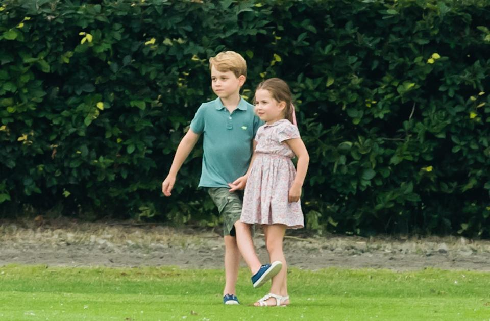 <p>Prince George and Princess Charlotte enjoyed playing outside at The King Power Royal Charity Polo Day at Billingbear Polo Club in July 2019. Dad William was competing. (Samir Hussein/WireImage)</p>