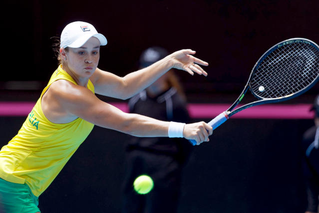 Australia's Ashleigh Barty returns to France's Caroline Garcia during their Fed Cup tennis final in Perth, Australia, Saturday, Nov. 9, 2019. (AP Photo/Trevor Collens)
