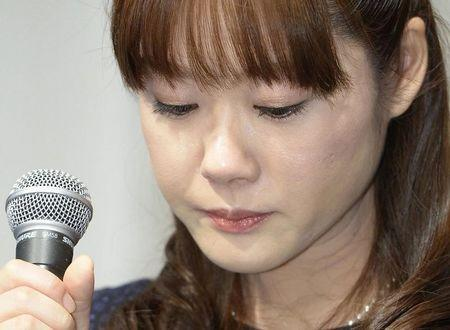 Haruko Obokata, a researcher at semi-governmental research institute RIKEN, lowers her eyes during a news conference in Osaka