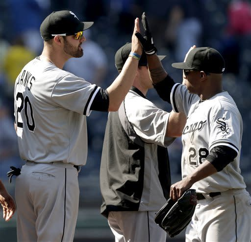 Chicago White Sox's Jordan Danks (20) celebrates with Dewayne Wise (28) after a baseball game against the Kansas City Royals, Monday, May 6, 2013, in Kansas City, Mo. The White Sox won 2-1 in 11 innings. (AP Photo/Charlie Riedel)