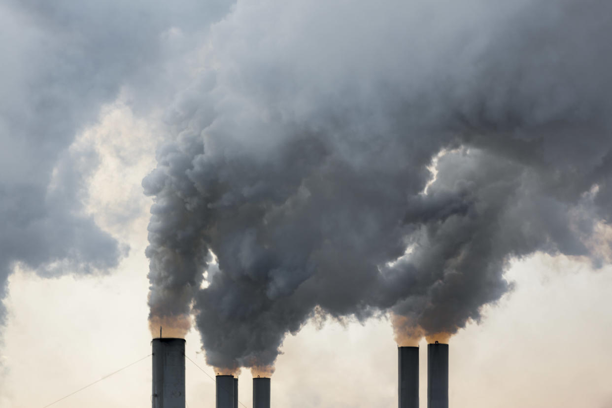 Plumes of smoke rise from chimneys at an industrial area in Greece.