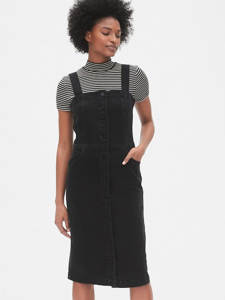 "<p>Layer a tee or turtleneck under this <a href=""https://www.popsugar.com/buy/Gap-Apron-Button-Front-Denim-Dress-478721?p_name=Gap%20Apron%20Button-Front%20Denim%20Dress&retailer=gap.com&pid=478721&price=70&evar1=fab%3Aus&evar9=46489263&evar98=https%3A%2F%2Fwww.popsugar.com%2Fphoto-gallery%2F46489263%2Fimage%2F46489266%2FGap-Apron-Button-Front-Denim-Dress&list1=shopping%2Cfall%20fashion%2Cgap&prop13=api&pdata=1"" rel=""nofollow"" data-shoppable-link=""1"" target=""_blank"" class=""ga-track"" data-ga-category=""Related"" data-ga-label=""https://www.gap.com/browse/product.do?pid=493788002&amp;cid=8792&amp;pcid=8792&amp;grid=pds_6_138_1&amp;cpos=6&amp;cexp=1161&amp;cid=CategoryIDs%3D8792&amp;cvar=8262&amp;ctype=Listing&amp;cpid=res19081211494137791681167#pdp-page-content"" data-ga-action=""In-Line Links"">Gap Apron Button-Front Denim Dress  </a> ($70).</p>"