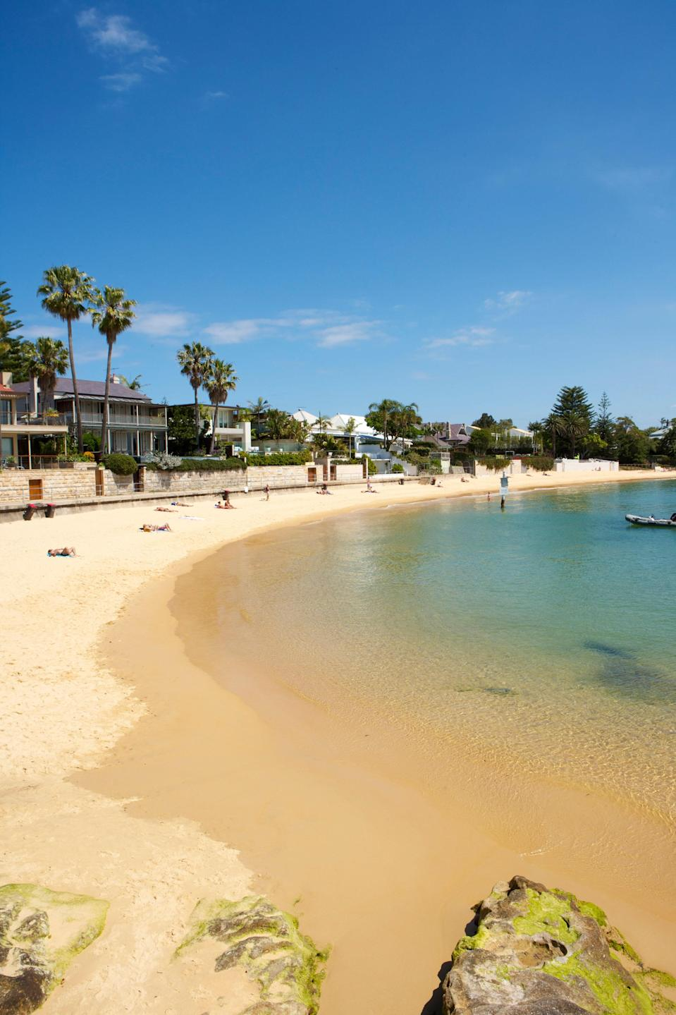 """<p><strong>Give us the wide-angle view: what kind of beach are we talking about?</strong><br> Cute little Camp Cove is the <a href=""""https://www.cntraveler.com/gallery/best-beaches-in-sydney?mbid=synd_yahoo_rss"""" rel=""""nofollow noopener"""" target=""""_blank"""" data-ylk=""""slk:Sydney beach"""" class=""""link rapid-noclick-resp"""">Sydney beach</a> of your dreams. A skinny arc of golden sand backed by private beach houses and palms and lapped by gentle turquoise water, it's only 262 yards long but makes up for its small size in charm. Camp Cove is located near Watsons Bay, just inland from the harbor's South Head.</p> <p><strong>How accessible is it?</strong><br> Camp Cove is an eight-minute walk from Watsons Bay Wharf, which you can access by taking a 23-minute ferry ride from Circular Quay. Buses run to Watsons Bay from Bondi (380, 24 minutes) and the city center (324 or 325, about 50 minutes). There's limited parking near the beach. Don't leave without exploring Watsons Bay, Australia's oldest fishing village, whose tranquil lanes are now lined with pastel flower-fringed cottages. From the wharf, turn left up Marine Parade, then take Cove and Pacific streets; or, if you've arrived by bus at the top of Robertson Park, walk along Cliff Street from Military Road.</p> <p><strong>Decent services and facilities, would you say?</strong><br> Headlands at each end of Camp Cove offer changing rooms with toilets and shady picnicking spots. There's an outdoor shower at the beach's north end beside Camp Cove Kiosk, which sells snacks, drinks, and popsicles. Alternatively, back at the wharf, Watsons Bay Boutique Hotel's all-day Beach Club serves delicious beer-battered fish and chips, fried calamari, burgers, and salads, plus refreshing cocktails, on three alfresco decks with harbor views. Next door, the fancier Doyles restaurant serves seafood on outdoor tables. You'll find ice cream stands and cafes on Military Road.</p> <p><strong>How's the actual beach stuff—sand and surf?</strong><br> This deli"""