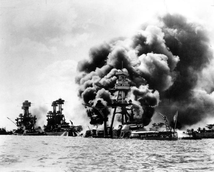 <p>Three U.S. battleships are hit from the air during the Japanese attack on Pearl Harbor on Dec. 7, 1941. From left are: USS West Virginia, severely damaged; USS Tennessee, damaged; and USS Arizona, sunk. (AP Photo) </p>
