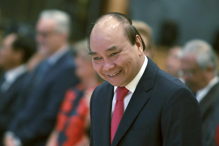 Vietnamese Prime Minister Nguyen Xuan Phuc arrives at the opening ceremony of the 36th ASEAN Summit in Hanoi, Vietnam Friday, June 26, 2020. Leaders from the Southeast Asian ten-nation bloc hold the bi-annual summit via online video conference to discuss regional issues. (AP Photo/Hau Dinh)