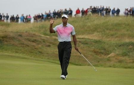 Tiger Woods of the U.S. gestures after making a birdie putt during the third round of the British Open Championship at the Royal Liverpool Golf Club in Hoylake