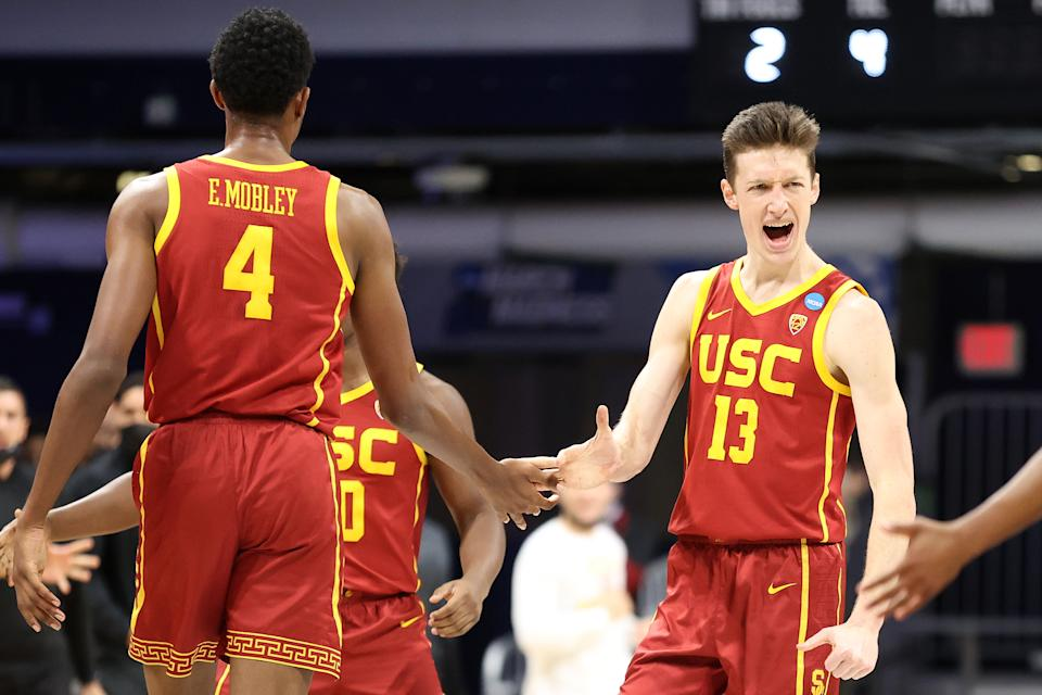 INDIANAPOLIS, INDIANA - MARCH 22: Drew Peterson #13 and Evan Mobley #4 of the USC Trojans react in the first half of their second round game against the Kansas Jayhawks in the 2021 NCAA Men's Basketball Tournament at Hinkle Fieldhouse on March 22, 2021 in Indianapolis, Indiana. (Photo by Andy Lyons/Getty Images)