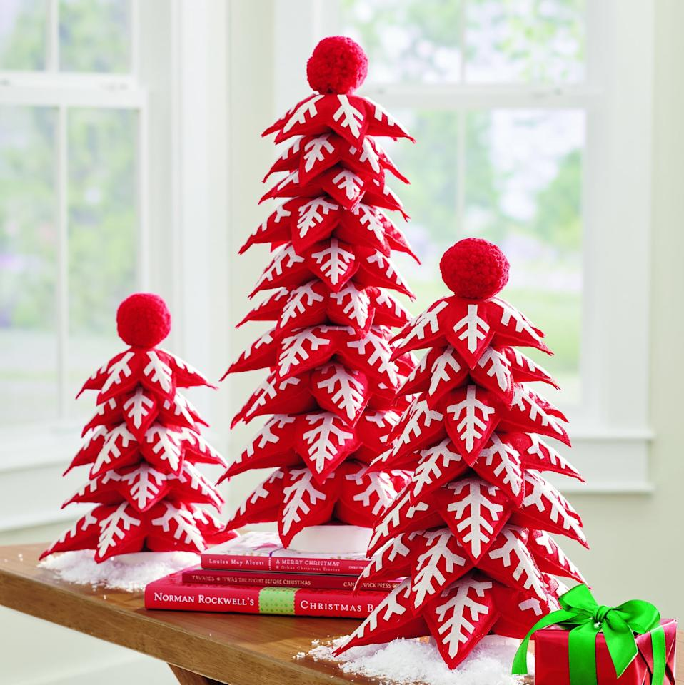 "<p> Add a whimsical touch to your tabletop display with these <a href=""https://www.popsugar.com/buy/Felt-Christmas-Trees-487798?p_name=Felt%20Christmas%20Trees&retailer=grandinroad.com&pid=487798&price=59&evar1=casa%3Aus&evar9=46570745&evar98=https%3A%2F%2Fwww.popsugar.com%2Fphoto-gallery%2F46570745%2Fimage%2F46570810%2FFelt-Christmas-Trees&list1=shopping%2Choliday%2Cchristmas%2Cchristmas%20decor%2Chome%20shopping&prop13=api&pdata=1"" rel=""nofollow"" data-shoppable-link=""1"" target=""_blank"" class=""ga-track"" data-ga-category=""Related"" data-ga-label=""http://www.grandinroad.com/felt-christmas-trees-2c-set-of-three/1295520?listIndex=0"" data-ga-action=""In-Line Links"">Felt Christmas Trees</a> ($59). </p>"