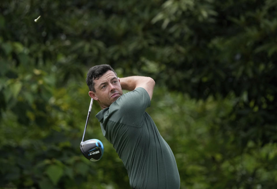 Rory McIlroy of Ireland watches his tee shot on the first hole during the third round of the men's golf event at the 2020 Summer Olympics on Saturday, July 31, 2021, in Kawagoe, Japan. (AP Photo/Andy Wong)