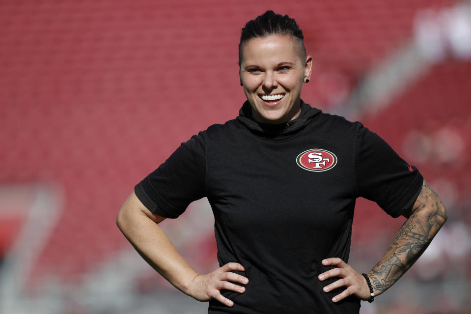 San Francisco 49ers offensive assistant Katie Sowers watches warms up before an NFL football game against the Arizona Cardinals in Santa Clara, Calif., Sunday, Nov. 17, 2019. She made such an impression on then-Falcons offensive coordinator Kyle Shanahan that he asked her to follow him to San Francisco when he was hired to coach the Niners. (AP Photo/Josie Lepe, File)
