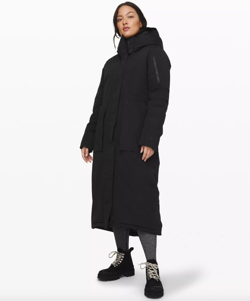 black long Winter Warrior Long Parka and black lace up snow boots