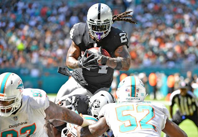 <p>Marshawn Lynch #24 of the Oakland Raiders scores a touchdown in the third quarter against the Miami Dolphins at Hard Rock Stadium on September 23, 2018 in Miami, Florida. (Photo by Mark Brown/Getty Images) </p>